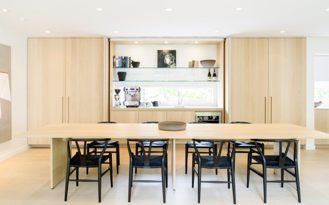 open concept dining room bleached pine table and cabinetry