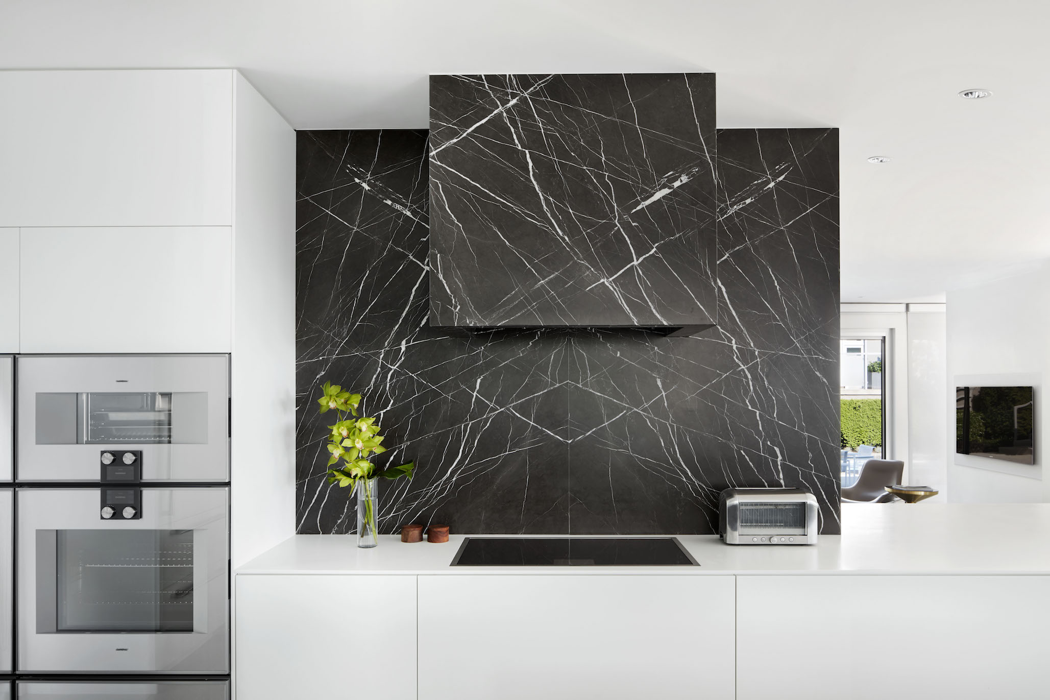 Modern kitchen with black marble backsplash